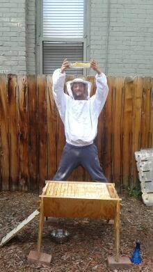 Tristan Copley Smith displays bees