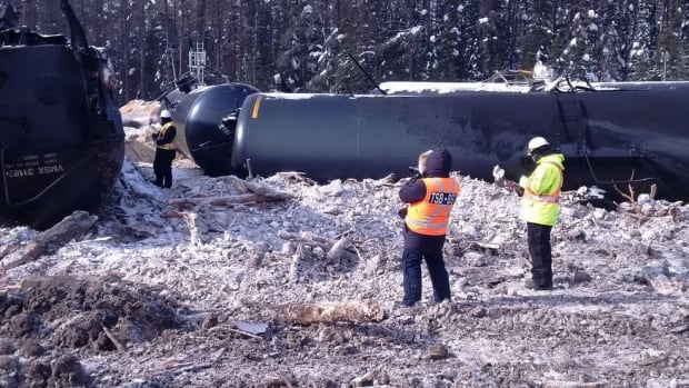 Transportation Safety Board investigators document the site of the fiery train derailment in the bush not far from Gogama on Feb. 14, 2015. A second CN oil train would derail much closer to the small town three weeks later.