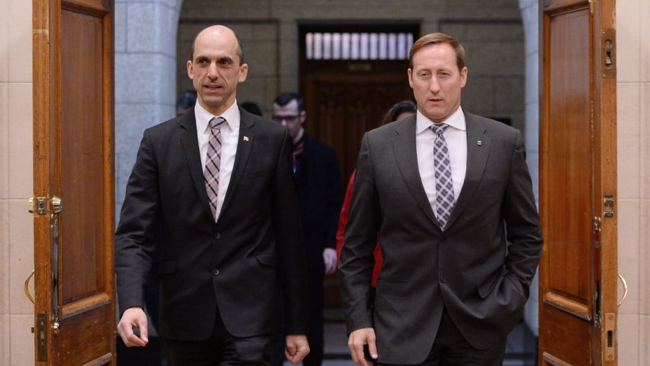Justice Minister Peter MacKay, right, and Public Safety Minister Steven Blaney arrive to appear at a Commons human rights committee on Parliament Hill in Ottawa on Monday, February 2, 2015. THE CANADIAN PRESS/Sean Kilpatrick