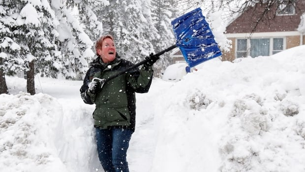 She may look happy, but it's better to push the snow, instead of throwing it.