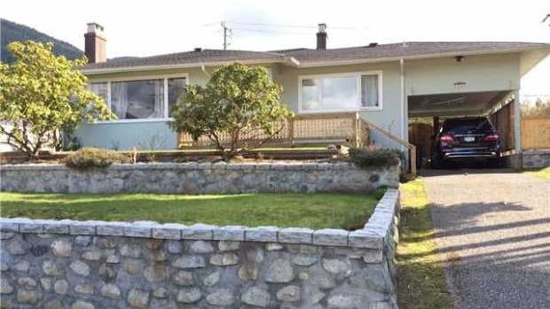 This home in North Vancouver has been listed for $1,180,000. Real estate agents say declining inventory and low interest rates have made such homes in the suburbs hot properties.