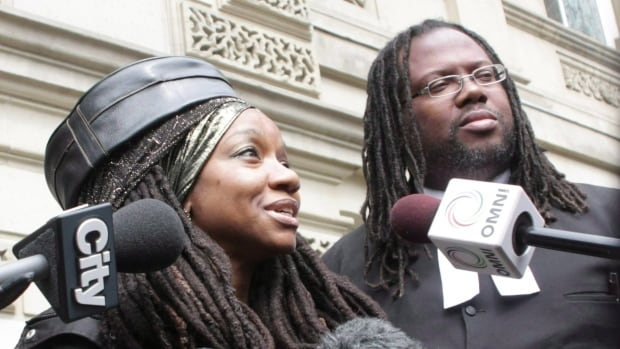 Jamaican citizen Simone Topey, left, seen with her lawyer Selwyn Pieters in 2014, is one of three permanent residents in Canada who fought against the citizenship oath's inclusion of a pledge of allegiance to the Queen. Topey and the others lost their case and the Supreme Court has declined to hear their appeal.