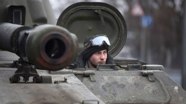 The driver of a mobile artillery cannon of the separatist self-proclaimed Donetsk People's Republic army waits for his convoy to  start pulling back from Donetsk, eastern Ukraine on Thursday.