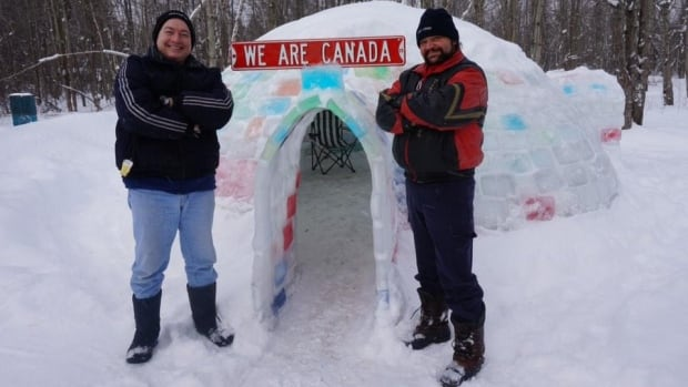 Dan McGuire (left) and Al Mackenzie (right) built a backyard igloo out of ice blocks in Oxford Station.