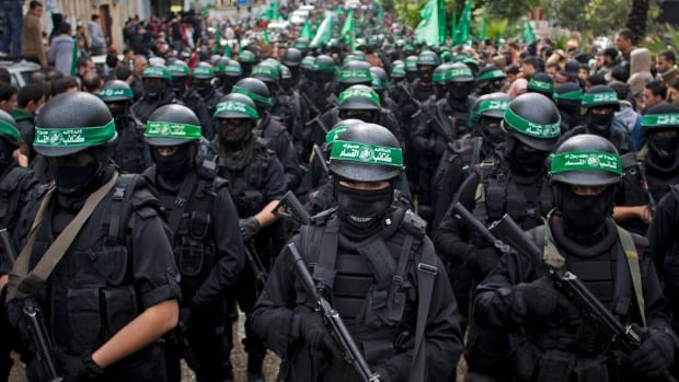 """In this file photo, members of Hamas display their military skills during a  commemoration of the group in Gaza City. An Egyptian court declared Hamas a """"terrorist organization"""" on Saturday."""
