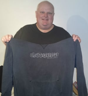 Coun. Rob Ford holding sweatshirt