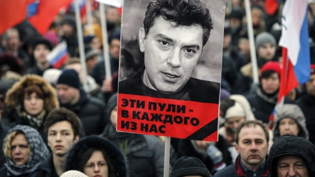 Tens of thousands march to commemorate Kremlin critic Boris Nemtsov in central Moscow March 1, 2015, many holding placards declaring 'I am not afraid.'