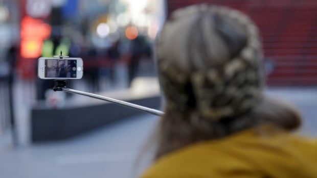 Selfie sticks, expandable rods that allow users to hold their cellphones a few feet away, making it easy to take your own wide-angled self-portraits or group shots.