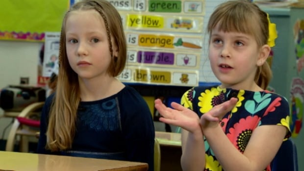 Fallyn Adams and Maddy Hansen will be among the Grade 1 students who will sing Love Can Build a Bridge at Tuesday's memorial service in Mayerthorpe.