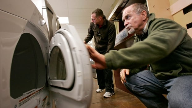 A shopper examines a new dryer. A new French law will mandate that appliances must last longer than some of them currently do.