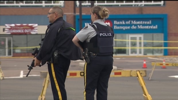 RCMP officers on the streets of Moncton, N.B., where three of their own were killed last June.