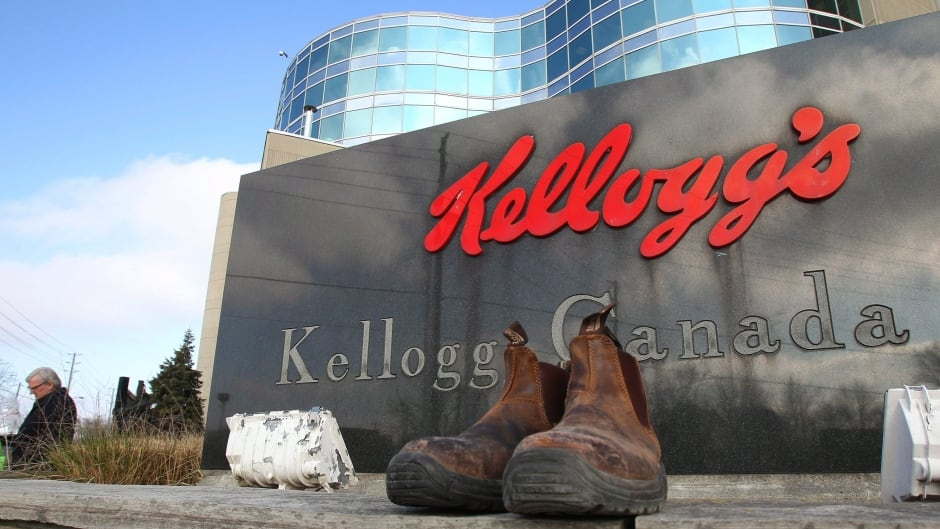 Discarded work boots rest in front of the Kellogg's Canada sign at the Kellogg's plant in London, Ont., on Monday, Dec. 22, 2014. The staff gathered one last time for a lunch on the final day of work, as the plant closes after a 107 year history of producing cereal. THE CANADIAN PRESS//Dave Chidley