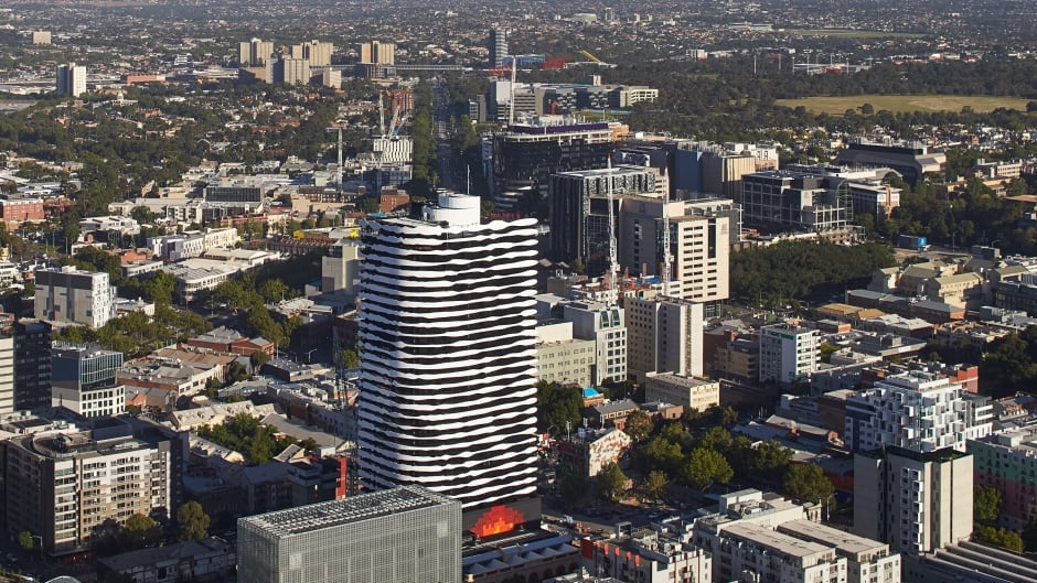 An newly-build apartment tower in Melbourne, Australia has the face of indigeneous leader William Barak etched into the balconies.