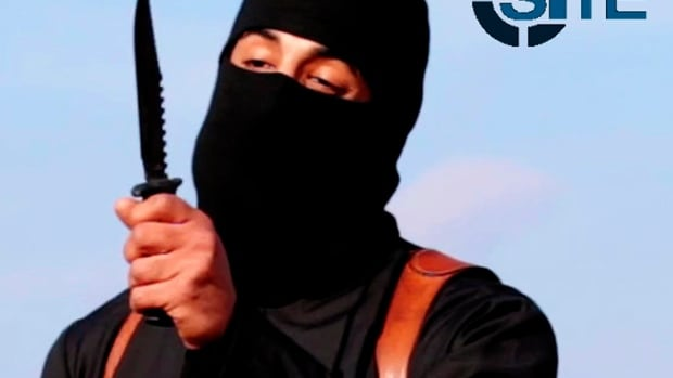 ISIS militant Mohammed Emwazi, known by the nickname 'Jihadi John' brandishes a knife in this still image from a 2014 video. A media outlet linked to the extremist organization has confirmed Emwazi is dead.