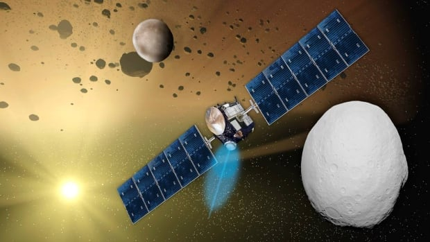 An artist's impression of the Dawn probe at Vesta in the asteroid belt.