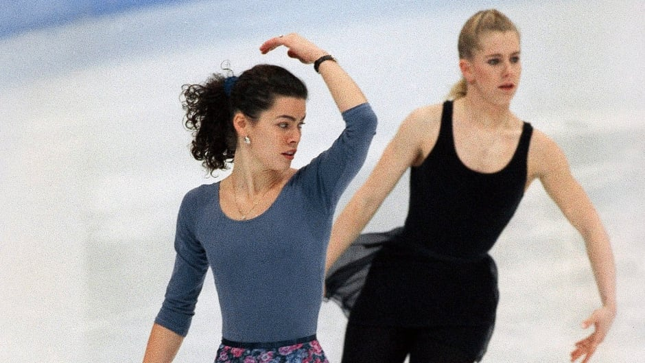 In this Feb. 22, 1994 file photo, American figure skaters Nancy Kerrigan (left) and Tonya Harding work out during an Olympic practice session at Hamar Olympic Amphitheater in Hamar, Norway.