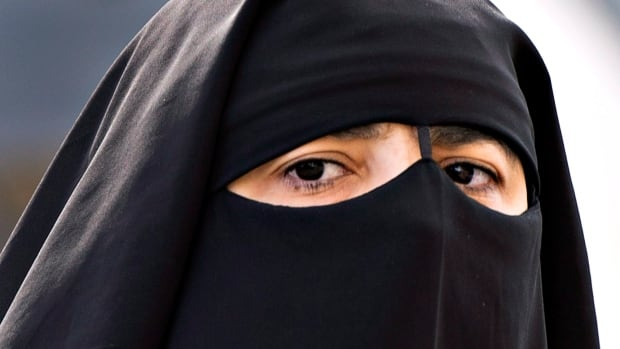 The issue of whether or not women should be able to wear the niqab, above, during citizenship ceremonies has become central in the election campaign.