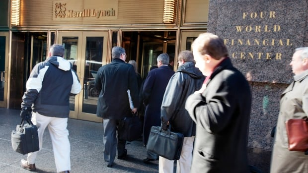 Workers arrive at Merrill Lynch headquarters, one of the big Wall Street investment houses, where average salaries topped $172,000 a year last year.