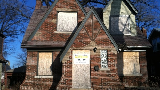 An abandoned house in Detroit, one of thousands of the city plans to foreclose this spring to auction off for $500 apiece. Just because it's boarded up, doesn't mean noone is living there.