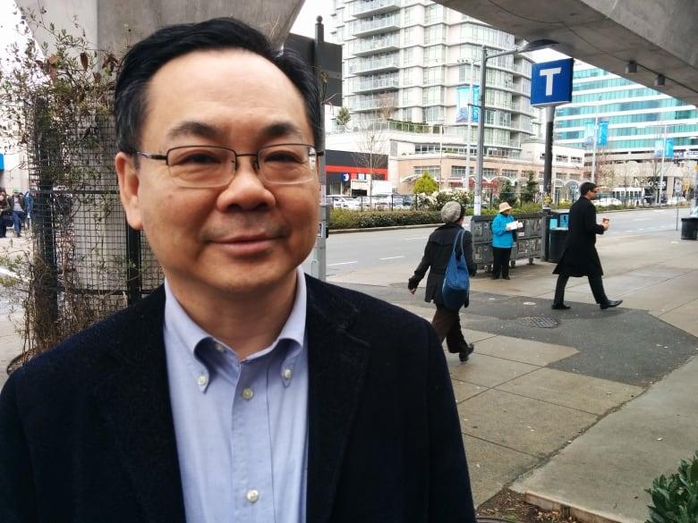 Image result for Chak Au, a member of Richmond city council since 2011