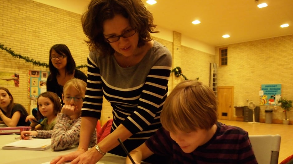 Anna Stokke works with kids to help them improve their math skills.