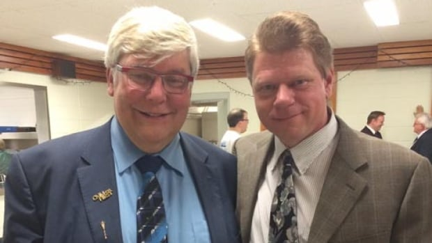 Steve Benson (right), shown here with former premier Dave Hancock, is alleging someone from another campaign offered him cash to withdraw from the PC nomination race in Edmonton-Meadowlark.