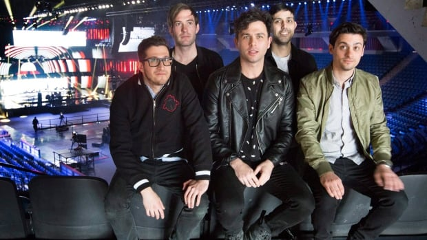 Hometown heroes, the Arkells, pose for photographers after a rehearsal on the Juno stage during a media preview of the set in Hamilton, Ont., on Friday. The band took home group of the year honours on Saturday.