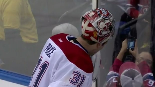Montreal goalie Carey Price posed for a quick photo with a young fan at rinkside.