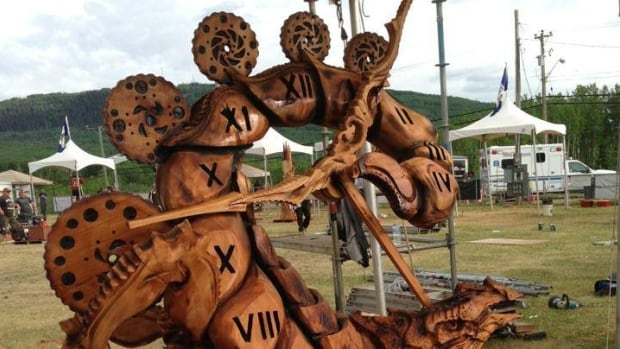 Oregon carver Chris Foltz won the 2014 Chetwynd International Chainsaw Carving Championship with his piece, Killing Time.