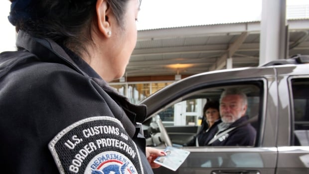 In this April 9, 2009 photo, a U.S. Customs and Border Protection officer speaks with a couple at a border crossing from Canada into the United States. CAA Manitoba says the current government shutdown won't have a major effect on travellers to the U.S.