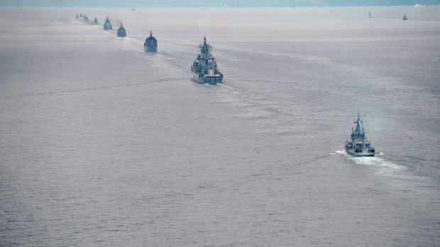 Russian Pacific Navy ships sail near the Sakhalin Island during military exercises two years ago. Moscow has spent almost $600 billion over the past decade upgrading its military.