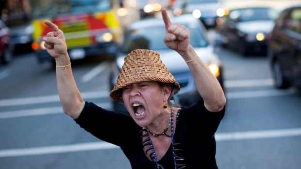 Demonstrators block a road during a protest in the streets following the federal government's approval of Enbridge's Northern Gateway pipeline in Vancouver, in June 2014.  The B.C. Civil Liberties Association alleges that CSIS broke the law by gathering information on peaceful protesters.