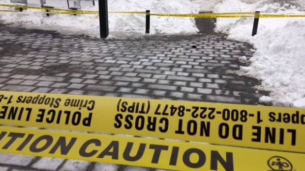 Police tape marks the spot where the man was stabbed.