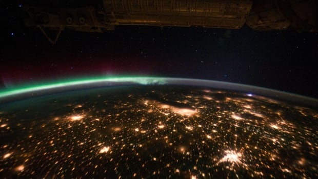 A photograph taken by an Expedition 29 crew member on the International Space Station shows a view of the aurora borealis over the U.S. Midwest.
