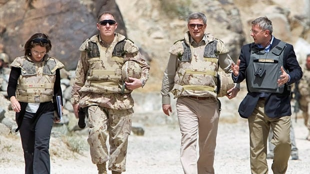 Prime Minister Stephen Harper visits the Dahla Dam, Canada's signature irrigation project in southern Afghanistan in 2009. He is flanked by ambassador Ron Hoffmann, right, then chief of defence staff Walter Natynczyk, and Chantal Ruel, with CIDA.