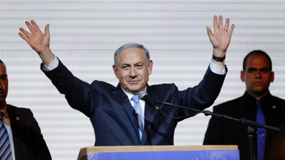 Israeli Prime Minister Benjamin Netanyahu waves to supporters at the party headquarters in Tel Aviv.