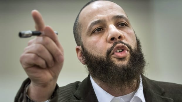Adil Charkaoui makes a point during a news conference Friday, February 27, 2015 in Montreal. Charkaoui blasted a decision by two Montreal junior colleges to suspend leases granted to his Arabic schools.