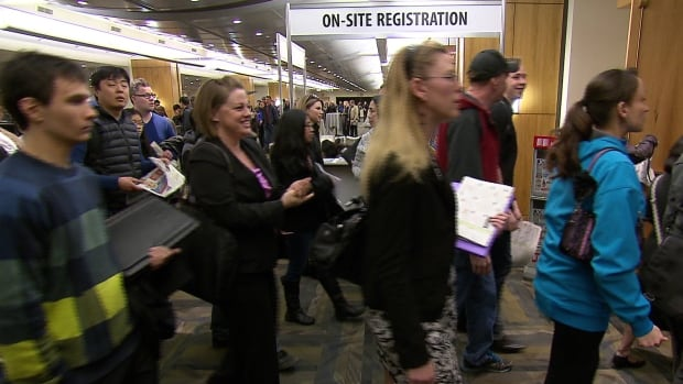 Job hunters line up at a job fair in Calgary in March.