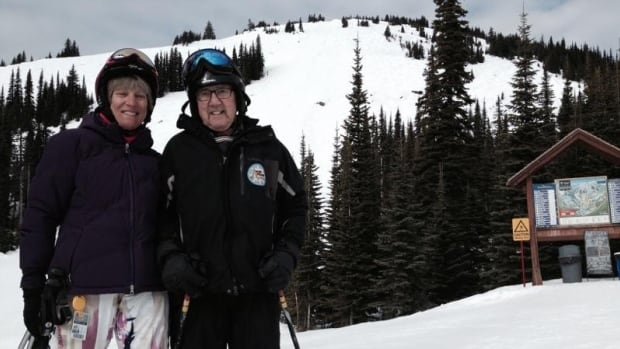 Pat McKimmon, president of Adaptive Sports, and 85-year-old skier Nick Maika stand in front the double black diamond run that Nick skied yesterday, twice