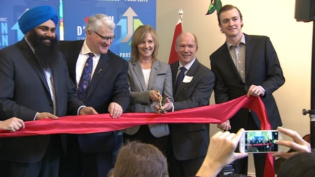 Cutting the ribbon for the grand opening of Iris Court on Thursday were (left to right) MP Tim Uppal, MLA David Dorward, Rubyann Rice and Len O'Connor from the Schizophrenia Society, and Oilers goalie Ben Scrivens.