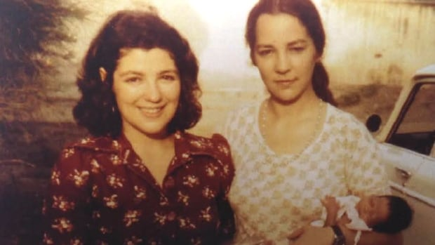 Eloise Charet (left) and her sister Anna are pictured at the orphanage they founded in Phnom Penh, Cambodia, in 1975.