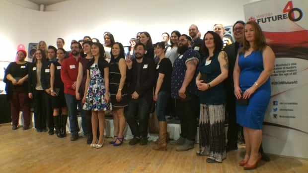 The finalists in CBC Manitoba's Future 40 initiative pose for a group photo during the awards gala at Artspace on March 19.