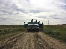 Friends in a pick-up truck
