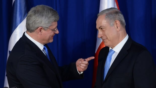 Prime Minister Stephen Harper and Israeli Prime Minister Benjamin Netanyahu talk in Jerusalem in January 2014. In a phone call with the re-elected Netanyahu, Harper reiterated Canada's support for a two-state solution for Palestinians and Israelis after Netanyahu made a hardline stance.