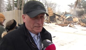 Real estate agent Larry Hann outside demolition of Winter Avenue home