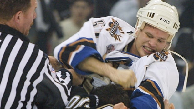 Washington Capitals' Stephen Peat, facing camera, punches Pittsburgh Penguins Krzysztof Oliwa during a game in Pittsburgh in 2001.