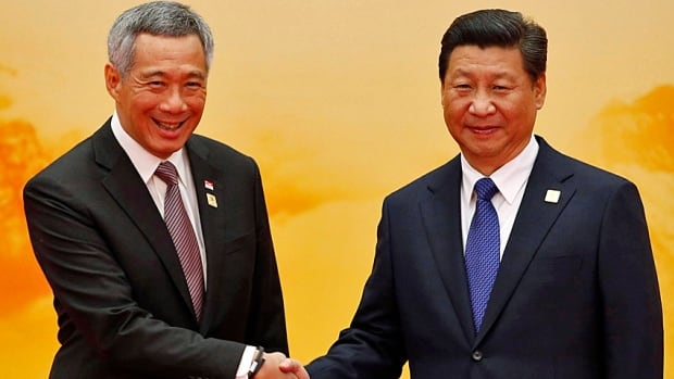 Singapore's Prime Minister Lee Hsien Loong, the son of the late Lee Kuan Yew, shakes hands with China's President Xi Jinping at the APEC summit in 2014. Lee's Singapore was a model for much of what China tried to do these past 20 years.