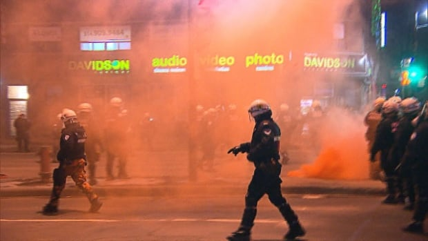 police officer smoke bomb montreal protest