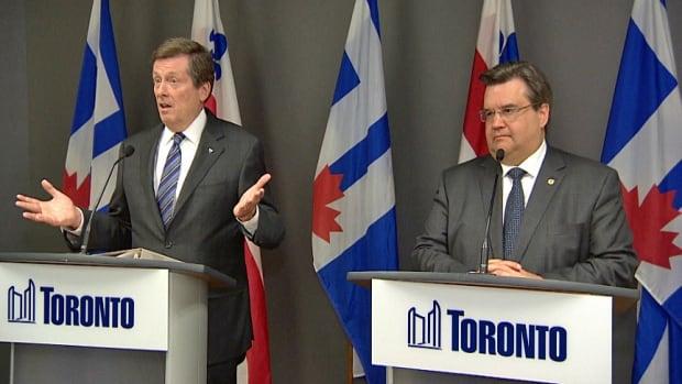 Toronto Mayor John Tory, left, is seen speaking with reporters, alongside Montreal Mayor Denis Coderre on Wednesday morning.