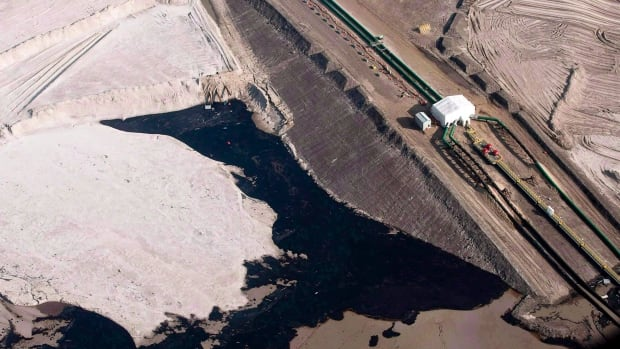 An oilsands facility is seen from a helicopter near Fort McMurray, Alta.